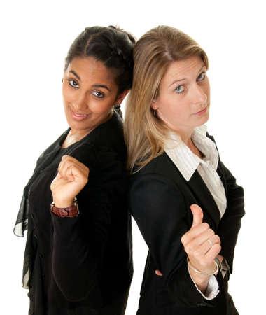 business rival: dos j�venes empresaria en una pose rivales Foto de archivo