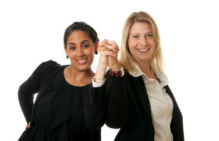 a young team of businesswomen posing confident