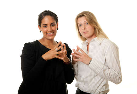 two young women in a pose of intellectual superiority Stock Photo