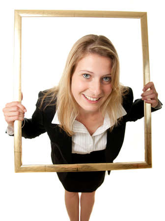 a wide-angle shot of a young businesswoman looking through a pictureframe Stock Photo