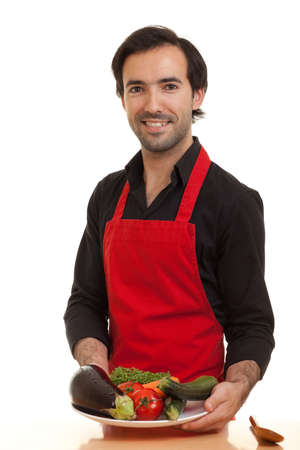 a chef presenting a bowl of vegetables Stock Photo
