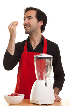 a chef gesturing about good taste with a blender in front of him Stock Photo