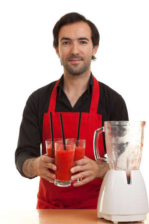 a chef holding some cocktails with a blender in front of him