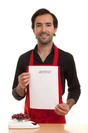 a chef holding an empty menu in front of him Stock Photo