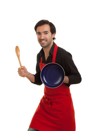 a chef posing with a cooking spoon and a pot cover as weapons as if he were a knight