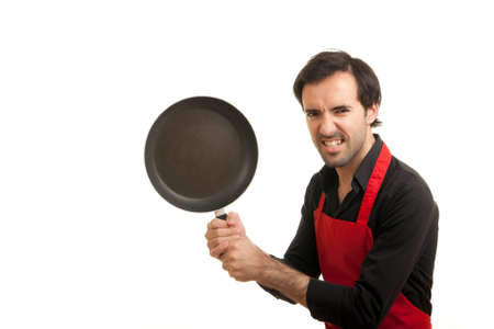 a crazy chef holding a pan like a weapon