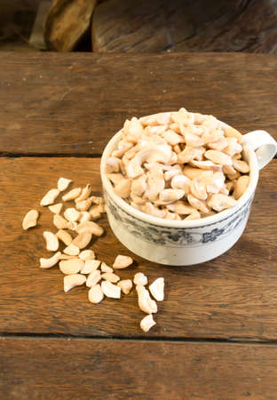Many pieces of cashew is in the coffee cup photo