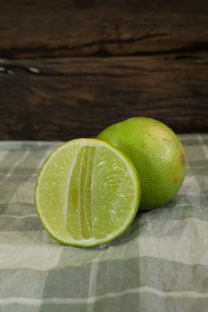 handkerchief: Fresh lime on the handkerchief ,on the wooden background