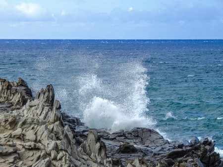 Coastline and rugged lava rocks geological worn marvels called Dragon�s Teeth and crashing waves in the ocean sea at Makaluapuna Point near Kapalua, Maui, HI, USA Stock Photo