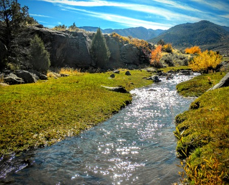 Utah Canyon Hiking Trail by river stream towards the Wasatch Mountains ATV four wheeling