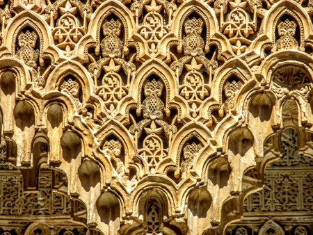 Detail of the intricate patterns on a wall of the Alhambra Palace in Granada, Spain. Muslim Arab Europe Roman Architecture