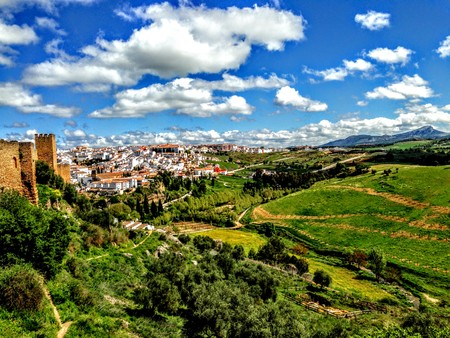 Ronda, Spain old town cityscape on the Tajo Gorge city clouds and farming countryside Stockfoto