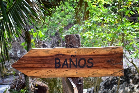 Banos, Bathroom Sign on the trail in El Eden by Puerto Vallarta Mexico where movies have been filmed. Stock Photo