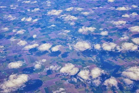 Aerial Cloudscape view over midwest states on flight over Colorado, Kansas, Missouri, Illinois, Indiana, Ohio and West Virginia during autumn. Grand sweeping views of landscape and clouds. Views of crops, rivers, plains, mountain and cloud patterns. Top view texture of clouds, USA.