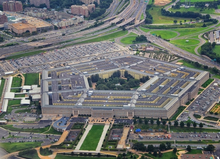 Aerial view of the United States Pentagon, the Department of Defense headquarters in Arlington, Virginia, near Washington DC, with I-395 freeway and the Air Force Memorial and Arlington Cemetery nearby.