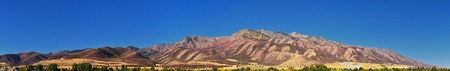 Logan Valley landscape views including Wellsville Mountains, Nibley, Hyrum, Providence and College Ward towns, home of Utah State University, in Cache County a branch of the Wasatch Range of the Rocky Mountains in Utah, in the Western United States.