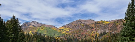 Guardsman Pass views of Panoramic Landscape of the Pass from the Brighton side by Midway and Heber Valley along the Wasatch Front Rocky Mountains, Fall Leaf Forests bright orange and yellow colors. Utah, United States.