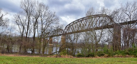 Train track railway bridge views along the Shelby Bottoms Greenway and Natural Area over Cumberland River frontage trails, Music City Nashville, Tennessee. United States. Stock Photo