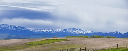 Tremonton and Logan Valley landscape views from Highway 30 pass, including Fielding, Beaverdam, Riverside and Collinston towns, by Utah State University, in Cache County along the Wasatch Front Range of the Rocky Mountains in Utah, USA.