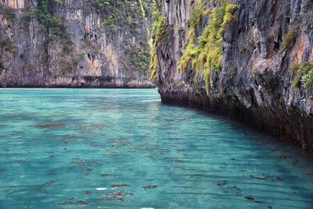 Island, Ocean views near Phuket Thailand with Blues, Turquoise and Greens oceans, mountains, boats, caves, trees resort island of phuket Thailand. Including Phi Phi, Ko Rang Yai, Ko Li Pe and other islands. Asia. Stock Photo