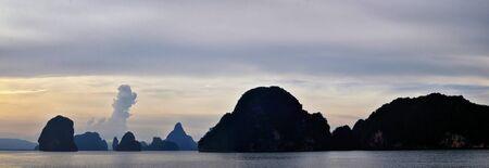 sland, Ocean views near Phuket Thailand with Blues, Turquoise and Greens oceans, mountains, boats, caves, trees resort island of phuket Thailand. Including Phi Phi, Ko Rang Yai, Ko Li Pe and other islands. Asia.