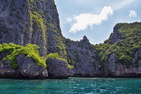 Island, Ocean views near Phuket Thailand with Blues, Turquoise and Greens oceans, mountains, boats, caves, trees resort island of phuket Thailand. Including Phi Phi, Ko Rang Yai, Ko Li Pe and other islands. Asia. Stok Fotoğraf