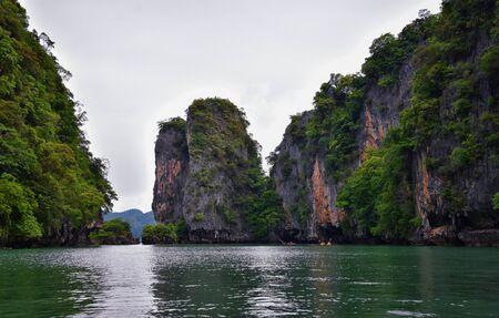 Island, Ocean views near Phuket Thailand with Blues, Turquoise and Greens oceans, mountains, boats, caves, trees resort island of phuket Thailand. Including Phi Phi, Ko Rang Yai, Ko Li Pe and other islands. Asia. Stock Photo