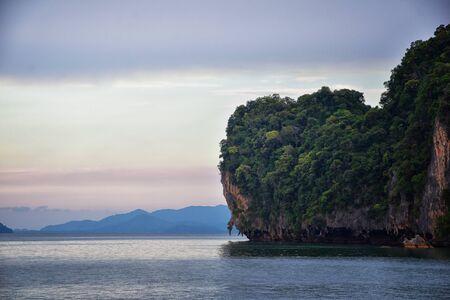 Islands Sunset, Ocean panorama views near Phuket with deep Red, Orange, Purple and Blue, mountains, twilight in Thailand. Including Phi Phi, Ko Rang Yai, Ko Li Pe and other islands. Asia. Reklamní fotografie
