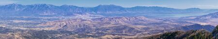 Wasatch Front Rocky Mountain landscapes from Oquirrh range looking at Utah Lake during fall. Panorama views near Provo, Timpanogos, Lone and Twin Peaks. Salt Lake City. United States.