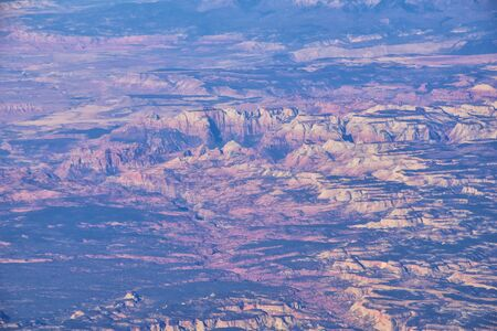Zions National Park in Utah, Aerial view from airplane of abstract Landscapes, peaks and canyons by Saint George, United States of America. USA.