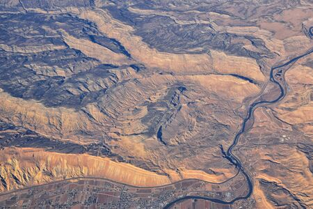 Colorado Rocky Mountains Aerial panoramic views from airplane of abstract Landscapes, peaks, canyons and rural cities in southwest Colorado and Utah. United States of America. USA.