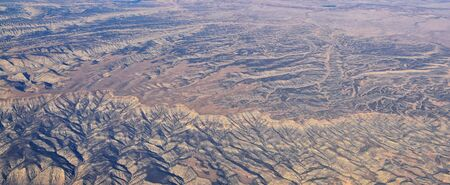 Colorado Rocky Mountains Aerial panoramic views from airplane of abstract Landscapes, peaks, canyons and rural cities in southwest Colorado and Utah. United States of America. USA. Stock fotó