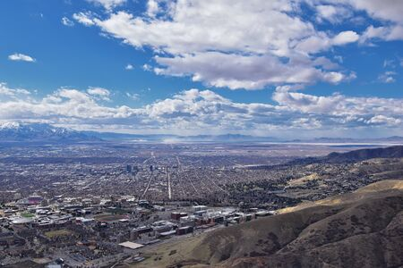 Salt Lake Valley and City panoramic views from the Red Butte Trail to the Living Room, Wasatch Front, Rocky Mountains in Utah early spring. Hiking view of trails around the University and Gardens and downtown. United States.