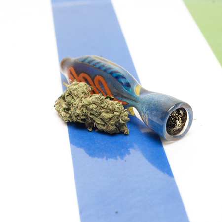 Marijuana and Cannabis on a Colorful Background photo