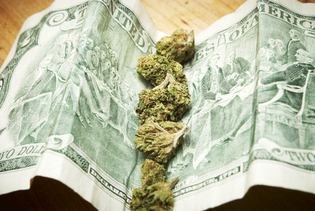 Marijuana and Cannabis Buds and Money, Drug Business American and Foreign Currency Stock Photo