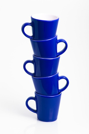 Isolated colorful stack of mugs