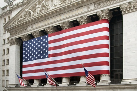 nyse: US Flag in front of New York Stock Exchange