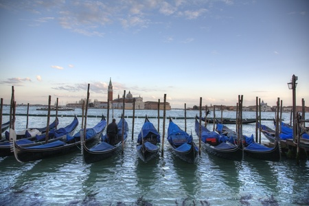 Famous Venice gondola at sunset, Italy Stock Photo