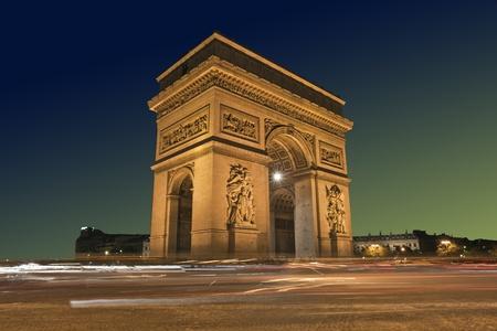 triomphe: Arc de Triomphe with passing traffic, Paris France