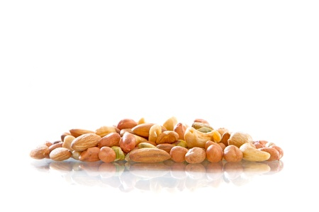 Mixed Nuts isolated on white background photo