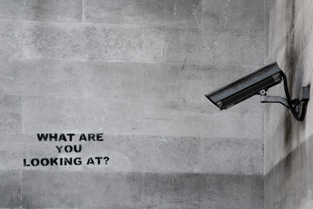 big brother spy: Banksy CCTV Graffiti Stock Photo