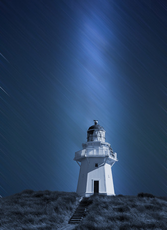 Lighthouse in New Zealand with the Milky Way photo