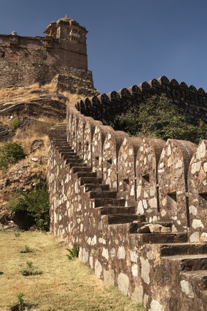 impregnable: Massive ramparts of Kumbhalgarh Fort with a palace at the top of the hill, Rajasthan, India.