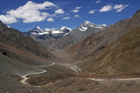 Manali to Leh mountain highway. Barren snow peaked mountains. Winding road. India photo