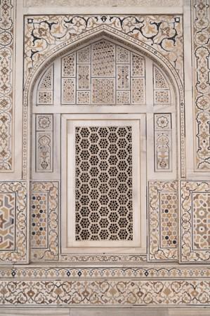 Ornate white marble muslim tomb inlaid with semi-precious stones (I'timad-ud-Daulah). Agra, India