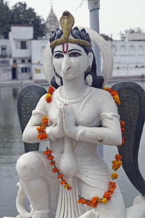 phallus: Durgiana Hindu Temple. Marble statue of religious deity garlanded in orange flowers. Amritsar, Punjab, India