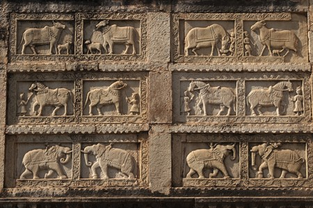 bullock animal: Bas relief carving of animals decorating the walls of the 84 pillared cenotaph, Bundi, Rajasthan, India