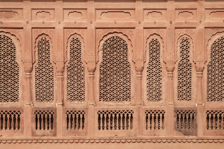 bikaner: Elaborately carved red sandstone windows of Junagarh Fort, Bikaner, Rajasthan, India
