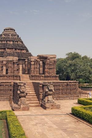 ad: Ancient Hindu Temple at Konark, Orissa, India. 13th Century AD. Large stone building set in landscaped gardens