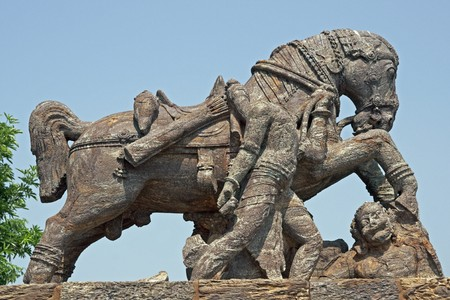 ad: Statue of a war horse trampling a man at the ancient Surya Hindu Temple at Konark, Orissa, India. 13th Century AD